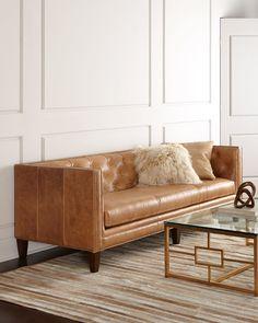 "<ul> <li>EXCLUSIVELY OURS.</li> <li>Handcrafted sofa.</li> <li>Hardwood frame.</li> <li>Leather upholstery.</li> <li>Includes one leather hairhide pillow and one Tibetan lambskin pillow.</li> <li>Suspended coil-spring system; mortise-and-tenon frame construction.</li> <li>90""W x 36""D x 32""T. Seat, 76""W x 21""D x 19""T; arms, 32""T.</li> <li>Made in t"