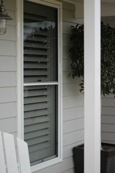 The white plantation shutters & sunscreen blinds I bought online Exterior Color Schemes, Exterior House Colors, Weatherboard Exterior, Facade House, House Facades, Outdoor Doors, Shutter Blinds, Light Grey Walls, Building A New Home