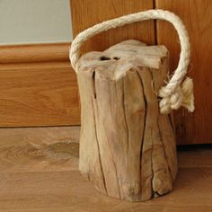 This lovely old gnarled piece of wood has been given a new lease of life as a door stop. The chunky piece of wood has a very rustic feel to it and does a great job of holding open a door. It's been made easy to move around, by the addition of a sturdy rope...Read More »