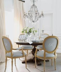 Love the blue chairs, round table, and embroidered initial.