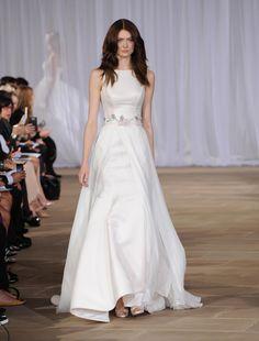 Ines Di Santo Fall 2016 A-line high neckline with flower belt wedding dress | https://www.theknot.com/content/ines-di-santo-wedding-dresses-bridal-fashion-week-fall-2016