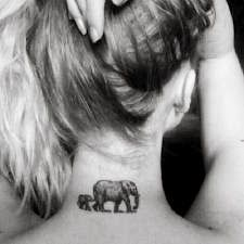 Elephant Tattoos. Not this location, but I love the mother/child meaning. And I love elephants.