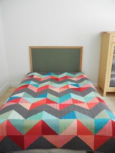 """I really dig the """"berry"""" colors in this chevron quilt by Stacey of Chickpea Studios."""
