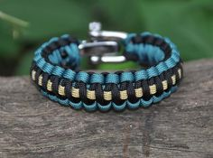 Survival Bracelet made of military spec 550 paracord.  In an emergency this bracelet can be unraveled and used to tow a vehicle, use as a tourniquet, secure a boat to a dock, or any other macgyver type thing with it. And they're made in the USA