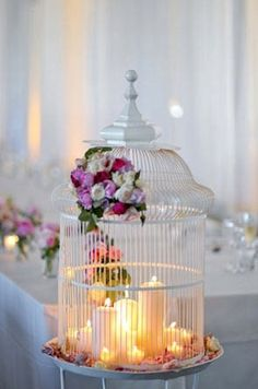 Bunch of candles inside a bird cage-- very unique centerpiece.