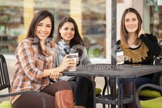 Pretty women having some coffee in a terrace royalty-free stock photo