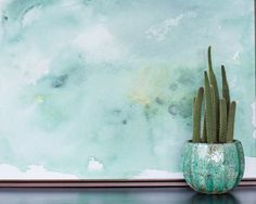 about this piece We just love all the crisp green colors this time of year… the Frasier fur, the sparkling spruce, the classic pine… This pretty green watercolor atop a snowy white background will bre