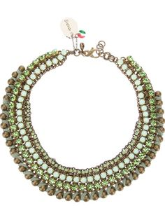 Thick brass 'Ankorvat' chain link necklace from Sveva Collection featuring a top clip fastening with a designer charm detail, a tonal green faceted gem and bead embellishment and a whip stitched trim.