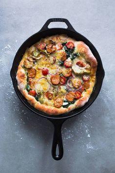 italian sausage, spinach, cherry tomatoes, artichoke hearts, and mozzarella pizza.