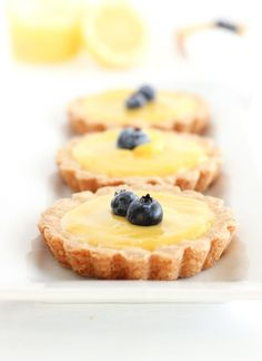Sweet and tangy Mini Meyer Lemon Tarts with buttery shortbread crusts are easy and delicious spring and summer desserts! Lemon Curd Pie, Lemon Curd Dessert, Lemon Desserts, Köstliche Desserts, Delicious Desserts, Dessert Recipes, Awesome Desserts, Lemon Bars, Plated Desserts