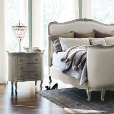 Our Genevieve bedroom collection perfectly embodies this aesthetic, featuring softly curved, feminine silhouettes and exquisite, hand-carved detailing. The dressers and nightstand are beautifully inlayed with natural, lightly colored marble and completed with aged pewter drawer pulls, keyholes and handles on faux-tray dresser tops. Check out Arhaus.com and start shopping today!