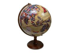This beautifully decorated vintage globe is an excellent reminder that if a butterfly flaps its wings on one side of the world, the effects will be felt on the other. Handmade by decoupage artist Wendy Gold, this globe is one-of-a-kind.