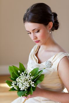 Simple and sweet, Lily of the Valley bouquet Florals by: Angela Austin/ Floral Design