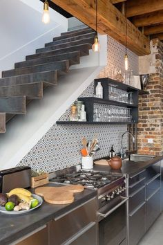 Modern Kitchen Interior a cozy French flat in the heart of Montmartre with floating metal stairs* brick* pretty tile* edison lights* Deco Design, Küchen Design, House Design, Stair Design, Design Ideas, Interior Design, Kitchen Dining, Kitchen Decor, Kitchen Ideas