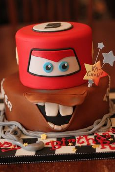 https://flic.kr/p/7Zo9gr | KA CHOW!!! | I got startled when I got the cake from the fridge after it had been out a site for a bit.  I guess I forgot what it exactly looked like....do you find Lightning-Mater looking a little sinister ; )  I think it's that cocked eye and that curled up lip....lol
