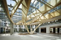 Office Building IN/OUT near Paris, re-designed foyer with wood beams