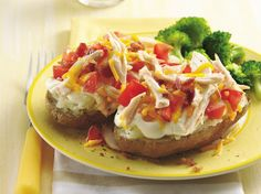 Turn classic stuffed potatoes into a satisfying meal  by adding shredded rotisserie chicken and diced plum tomatoes to traditional ingredients.