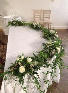 The registrar's table decorated with trailing foliage and roses.