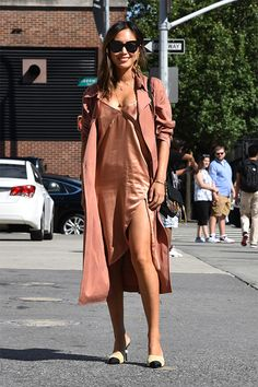 NYFW street style | Aimee Song wearing one of the hottest looks of the season -- a ravishing satin slip dress with a matching duster.