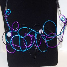 Where is the Love.. Black, purple & bright blue aluminium wire statement necklace With hidden message OOAK Free Postage handmade in Cairns aluminium wire