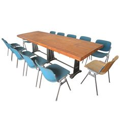 1stdibs | Italian Industrial Table by Gimo Fero  with Twelve Castelli Chairs
