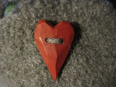 Pic to remind me that I should just whittle my own buttons. torunnbs handmade red hearted grey purse.