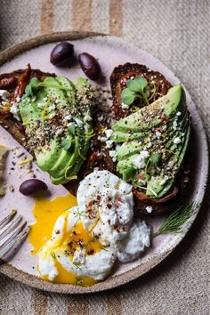 Avocado with poached egg and olives
