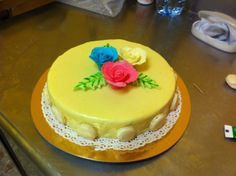White chocolate cake with macaron and gum paste  flowers