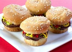 """""""Juicy Lucy"""" Burger Cupcakes. These are made with plain cupcakes, coconut, and three kinds of frosting. Seems like a wonderful way to freak out family, friends, co-workers, etc."""