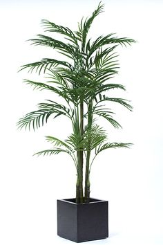 Artificial palm plant, this Areca palm is very 70's with its large leaf fronds.