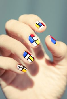 Mondrian nail art: five color colour geometric #modernism design using primary colors: blue, red, yellow and white squares and rectangles with black lines stripes using striping tape. #summer #spring 2013
