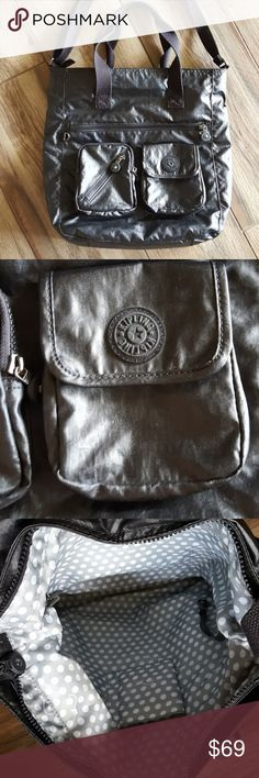 Kipling black computer/book bag Euc. Was one of my favorite bags ever. Loved but still in great condition. Inside is clean. The handles are slightly faded but not bad. Large size with tons of zip and slip compartments Kipling Bags