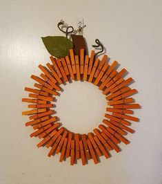Wreath Size: 14 Details: Wreath finished in a UV and moisture resistant clear coat to allow for outdoor hanging Easy Fall Wreaths, Easy Fall Crafts, Thanksgiving Wreaths, How To Make Wreaths, Holiday Wreaths, Wreath Crafts, Diy Wreath, Clothespin Crafts, Door Wreaths