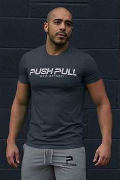 Form Fit Tee - Introducing the Form Fit Tee.  The Push Pull FormFit Tee is a new addition to our range of men's t-shirts, adapted to give a form-flattering fit.  The material blend features a polyester/cotton blend keeping you comfortable, and allows for the perfect amount of stretch. Tapered neck and shoulders, regular body fit.  Additional Features: Matte White Centered Mark Quarter turned to eliminate crease Washing Instructions: DO NOT WASH WITH WHITES - Colour will bleed slightly…