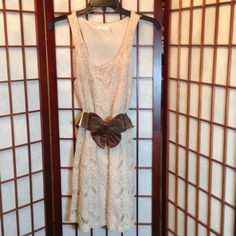 **REDUCED**Lace Dress with Polyester Lining Beautiful lace dress is fully lined and made of 80% cotton 20% polyester. So comfortable and fun to wear. Machine washable.  In excellent condition, no rips, tears, pulls or stains. Blue Bird Dresses