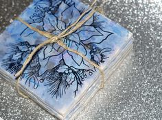 Everybody needs coasters. Make these really great stamped alcohol ink DIY upcycled tile coasters for every person on your list. They're quick and easy!