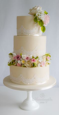 3 tier wedding cake with sugar roses Wedding cake with lots of sugar roses, foliage and freesia by Morningside Bakes, North Lanarkshire