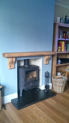 This waney edge solid oak mantel shelf looks great in place and livens up David Nandys fireplace perfectly (www.oakfiresurrounds.co.uk) Oak Mantel, Wooden Mantel, Mantel Shelf, Mantle, Stove Fireplace, Fireplace Ideas, Fireplace Mantels, Oak Fire Surround, Log Burner Living Room