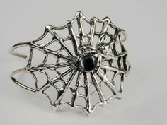 An Impressive Sterling Silver Spider Web Bracelet Accented with Genuine Hematite The Silver Dragon- Bracelets. $190.00. This Unique Bracelet is Created only after Your Order Arrives. Please Allow 7-10 days for Delivery.. This Bracelet Fits a Standard Woman's Wrist. This Bracelet was Designed by The Silver Dragon, a Jewelry Shop in New England. Thank you for Supporting American Business.. Designed And Hand- Crafted in Sterling Silver. The Silver Dragon uses Sterling Silver...