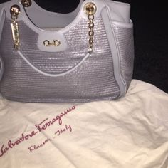 Ferragamo - Spring collection '14 Authentic... Baby Aqua blue handbag... perfect size to hold just anything! Salvatore Ferragamo Bags