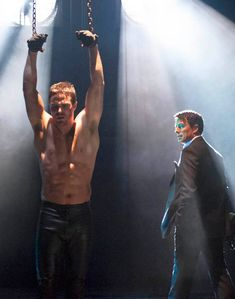 John Barrowman enjoys working with a shirtless Stephen Amell on Arrow