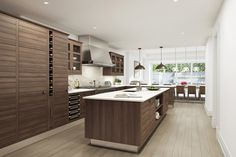Kitchen with rich wood cabinets, white quartz countertops and light maple flooring.