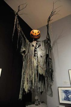 awesome pumpkin scare crow use chicken wire and branches for body and drape black plastic bags for cloak this is burtons scarecrow at the moma from - Scary Outdoor Halloween Decorations Diy