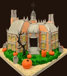 This amazing 3D Halloween Haunted House Cake is an amazing replica of our client's figurine. It is so intricate and has so many details but it came out perfect! The fondant pumpkins and tree completes the Halloween look!