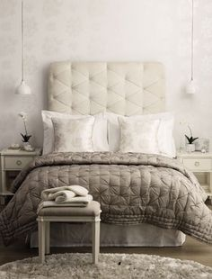 Go for an oversized headboard for that boutique hotel bedroom feel