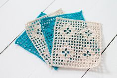 Lovely filet crochet coasters made by Signed With an Owl. Links for patterns in post.