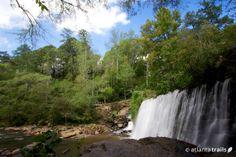 The Vickery Creek trail, a moderate 3 mile loop trail just outside Atlanta, hikes to 2 historic mills, a covered bridge, and an impressive historic dam along the Big Creek canyon near Atlanta, Georgia.