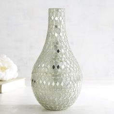 Beyond brilliance. Covered with tiny, mirrored-glass tiles—each placed by hand to create the shimmering, shining effect—our glass teardrop vase is a glamorous version of a timeless silhouette.
