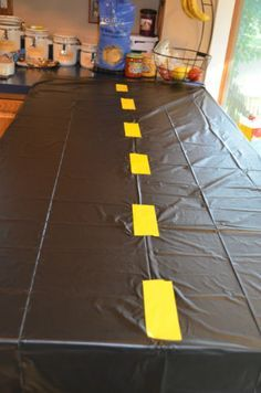 Race car themed party: racetrack made using plastic table covers ...