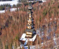 Alaska's Goose Creek Tower (Dr. Seuss House) is a whimsical tower made of stacked cabins